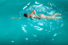 Swimming woman in pool. Royalty Free Stock Image