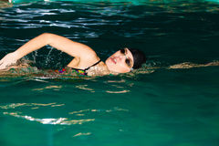 Swimming woman in pool. Stock Photography