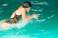 Swimming woman in pool. Swimming. Competition and recreation. Woman swimmer breathing. Poolside Stock Photos