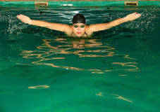 Swimming woman in pool. Royalty Free Stock Photos