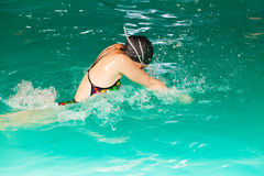 Swimming woman in pool. Swimming. Competition and recreation. Woman swimmer breathing. Poolside Royalty Free Stock Image