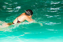 Swimming woman in pool. Swimming. Competition and recreation. Woman swimmer breathing. Poolside Stock Photography