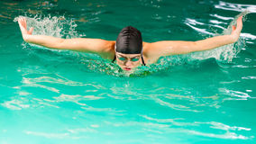 Swimming woman in pool. Swimming. Competition and recreation. Woman swimmer breathing. Poolside Royalty Free Stock Photography