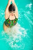 Swimming woman in pool. Swimming. Competition and recreation. Woman swimmer jump. Poolside Royalty Free Stock Images
