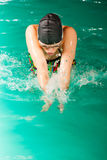 Swimming woman in pool. Swimming. Competition and recreation. Woman swimmer jump. Poolside Royalty Free Stock Photo