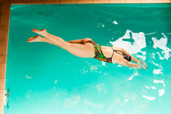 Swimming woman in pool. Swimming. Competition and recreation. Woman swimmer jump. Poolside Stock Photos