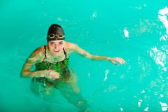 Swimming woman in pool. Swimming. Competition and recreation. Woman swimmer jump. Poolside Stock Photography