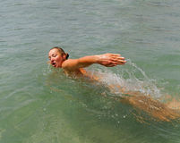 Swimming woman. Royalty Free Stock Photography