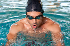 Swimming young man Royalty Free Stock Photography
