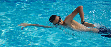 Swimming. A young swimming in a pool Royalty Free Stock Photography