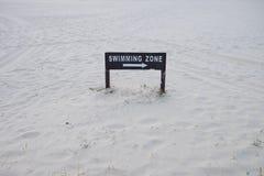 Swimming zone sign on beach. At rasa ria resort & spa royalty free stock image