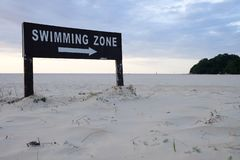 Swimming zone sign on beach stock photography