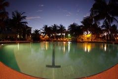 Swimmingpool am Abend Stockbilder