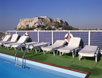 Swimmingpool and at background the Acropolis stock photo