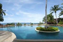 Swimmingpool an einem sonnigen Tag Stockbilder