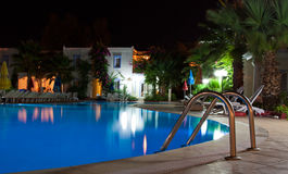 Swimmingpool at night. A swimming pool at night royalty free stock images