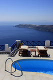 Swimmingpool set on a hill overlooking the sea. Royalty Free Stock Photography