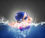 Swims in freestyle. Girl swims in the pool in freestyle Royalty Free Stock Photography