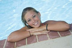 Swimsuit. Caucasian teen in swimsuit relaxing in pool Royalty Free Stock Photo