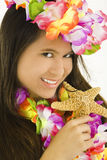 Swimsuit. Young Asian woman posing in a swimsuit with flowers and holding a starfish Stock Photo