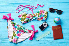 Swimsuit and accessories for going abroad. Colorful female swimsuit for rest in south Stock Photography