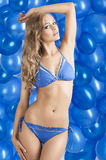 Swimsuit and balloons in blue, Stock Photos