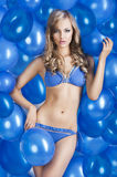 Swimsuit and balloons in blue, Royalty Free Stock Images