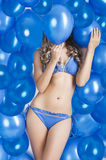 Swimsuit and balloons in blue, Royalty Free Stock Photos