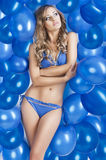 Swimsuit and balloons in blue, Royalty Free Stock Photography