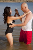 Swimsuit dance in water Stock Images