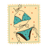 Swimsuit isolated on vintage postage stamp. Stock Image