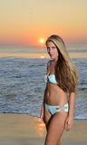 Swimsuit model on beach at sunrise Royalty Free Stock Images