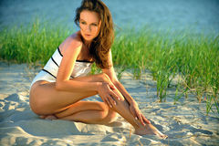 Swimsuit model posing on the beach Royalty Free Stock Photography