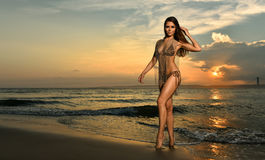 Swimsuit model posing at ocean beach location Stock Photography