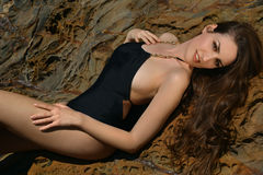 Swimsuit model posing sexy in front of black lava field Stock Images
