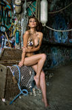 Swimsuit model posing sexy in front of graffiti background Royalty Free Stock Photos