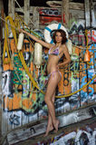 Swimsuit model posing sexy in front of graffiti background Stock Photo