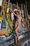 Swimsuit model posing sexy in front of graffiti background with marine style accessories Royalty Free Stock Images