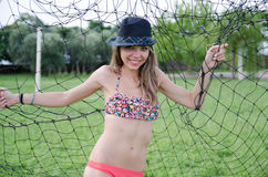 Swimsuit photo shoot under the field goal post Royalty Free Stock Photos