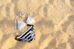 Swimsuit in the sand Royalty Free Stock Image