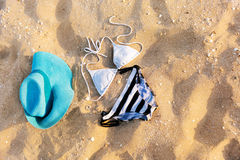 Swimsuit in the sand. Swimsuit and hat in the sand Stock Photos