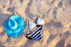 Swimsuit on the sand. Near the sea Stock Images