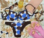 Swimsuit and starfish Stock Photo