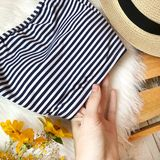 Swimsuit in stripes on the background of fur royalty free stock photos