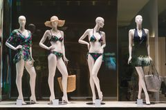Swimsuits in a store front royalty free stock photography