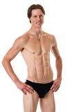 человек над белизной swimwear студии съемки Стоковое Фото