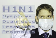Swine Flu. Man wearing mask and accessing H1N1 menu of symptoms, diagnosis, treatment and prognosis Stock Image