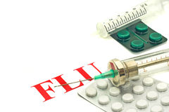 Swine FLU H1N1- old-fashioned syringes and pills Stock Image
