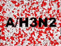 Swine Flu H3N2 epidemic pills background. And black word Stock Image