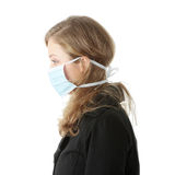 'Swine Flu' infection. A model wearing a mask to prevent 'Swine Flu' infection. Isolated Royalty Free Stock Photo